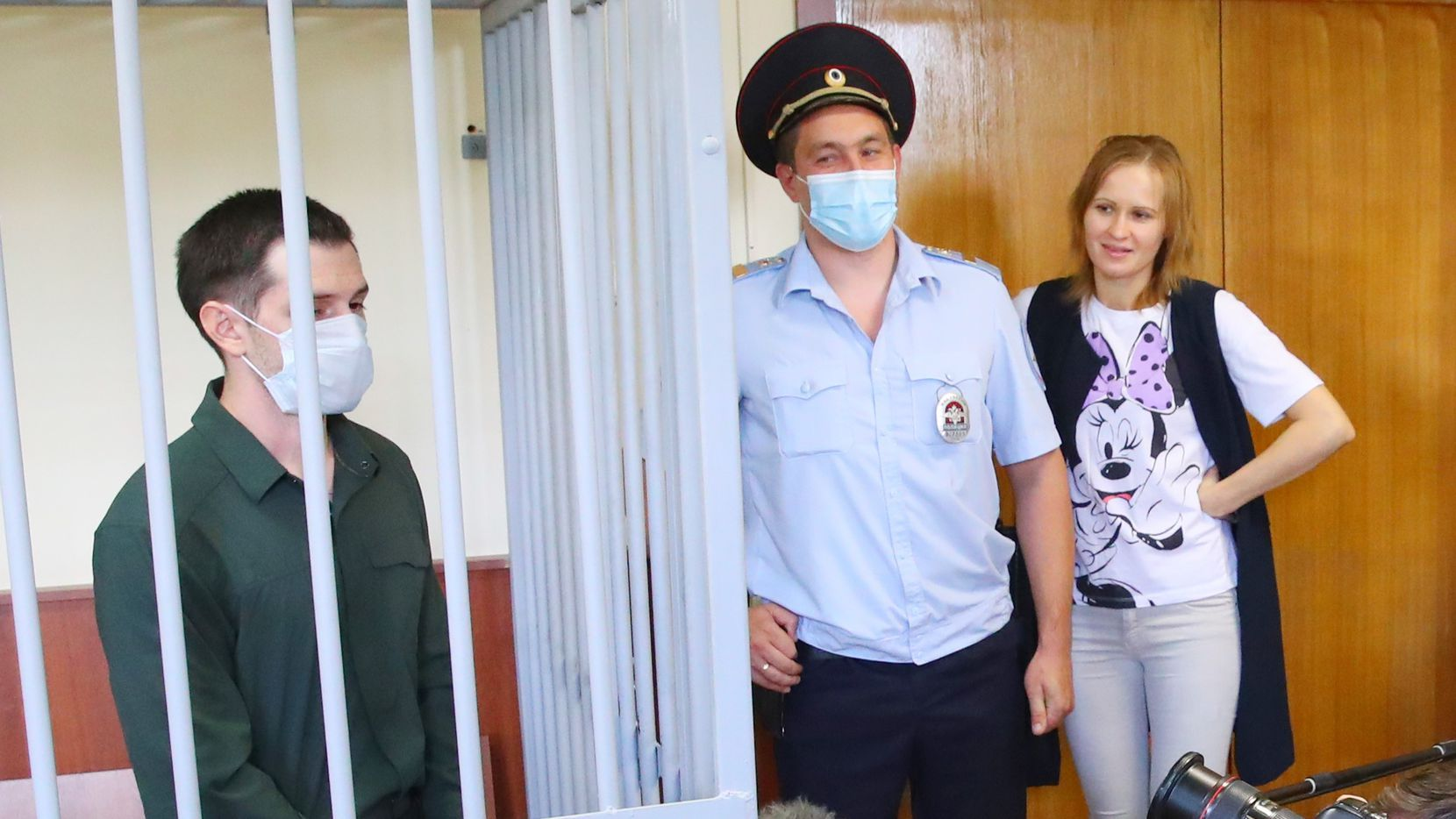 A former US Marine and University of North Texas student, Trevor Reed at his sentencing hearing July 30, 2020, at Moscow's Golovinsky District Court. The court found him guilty and sentenced him to 9 years in a prison colony. Reed, who arrived in Russia on a tourist visa, was arrested Aug. 16, 2019 after neighbors complained about a drunk man arguing with women. Authorities say he attacked officers as they took him to the police station, which he denies. U.S. officials and Reed's family and lawyer say the charges are baseless.
