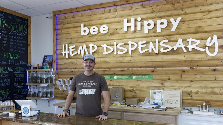 """Chris Fagan, owner of the Bee Hippy Hemp Dispensary in Garland, says he still believes products containing delta-8 THC are legal because there is a """"gray area"""" under a law that Gov. Greg Abbott signed in 2019 legalizing hemp products with less than 0.3 percent tetrahydrocannabinol. """"We're not losing sleep over it because we know the law hasn't changed,"""" Fagan said."""
