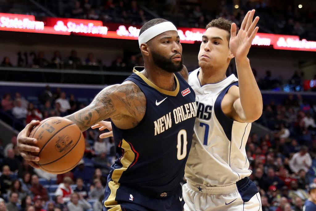 NEW ORLEANS, LA - DECEMBER 29:  DeMarcus Cousins #0 of the New Orleans Pelicans passes the ball around Dwight Powell #7 of the Dallas Mavericks at Smoothie King Center on December 29, 2017 in New Orleans, Louisiana.  (Photo by Chris Graythen/Getty Images)
