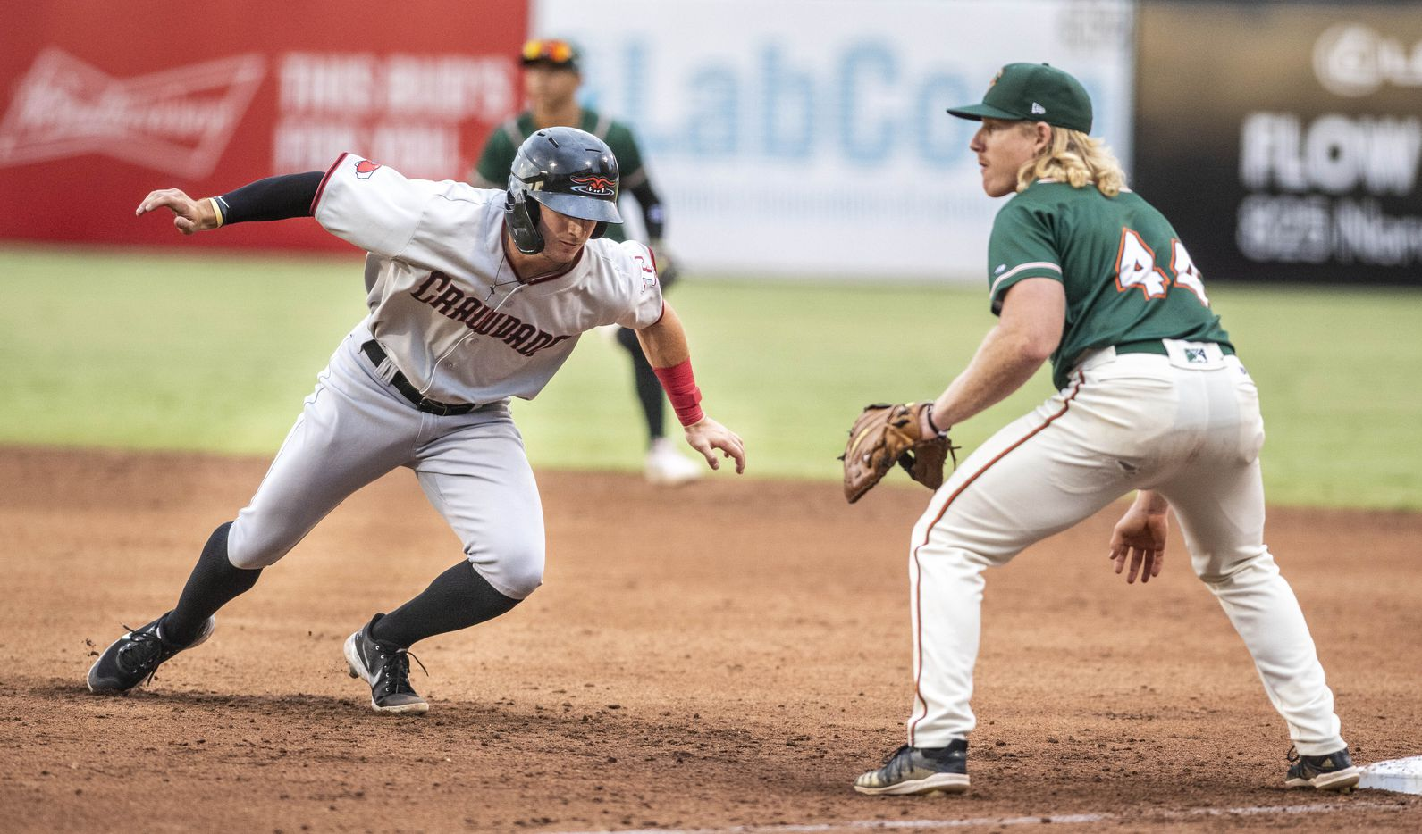 Hickory Crawdad's Trevor Hauver (33) gets back to first base during the game with the Greensboro Grasshopper's at First National Bank Field on Friday, August 6, 2021 in Greensboro, N.C. (Woody Marshall/Special Contributor)