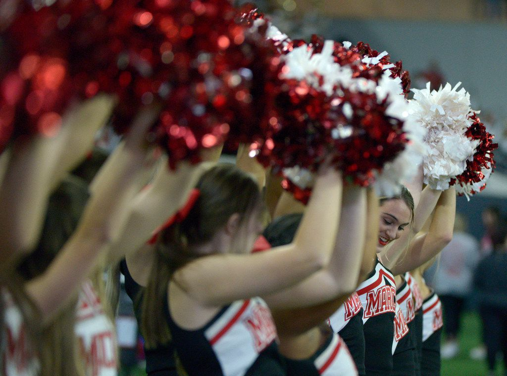 Flower Mound Marcus cheerleaders in the first half of a Class 6A Division II area round high school playoff football game between Flower Mound Marcus and Lake Highlands, Saturday, Nov. 23, 2019, in Frisco, Texas. (Matt Strasen/Special Contributor)