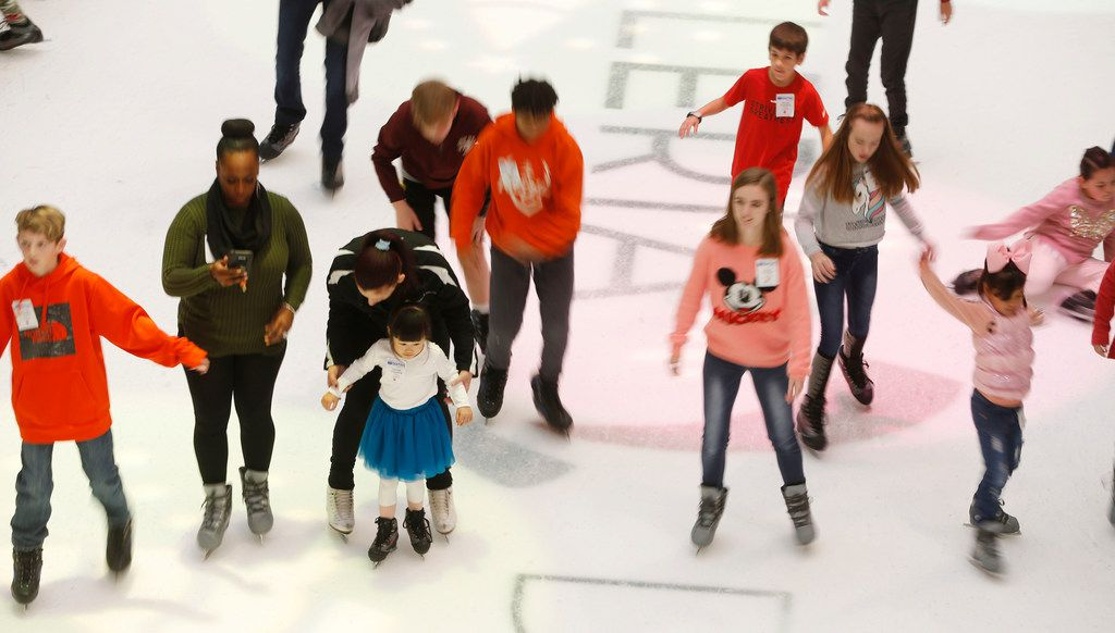 People skate around the ice rink at Galleria Dallas.