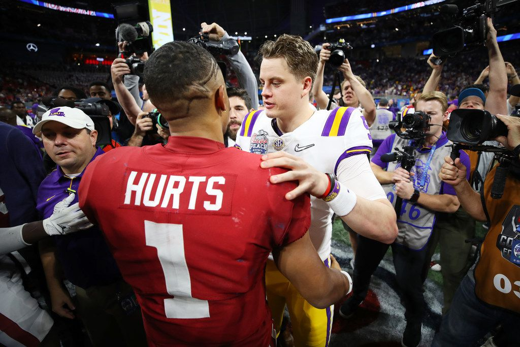 ATLANTA, GEORGIA - DECEMBER 28: Quarterback Joe Burrow #9 of the LSU Tigers and quarterback Jalen Hurts #1 of the Oklahoma Sooners embrace after the LSU Tigers win the Chick-fil-A Peach Bowl 28-63 at Mercedes-Benz Stadium on December 28, 2019 in Atlanta, Georgia.