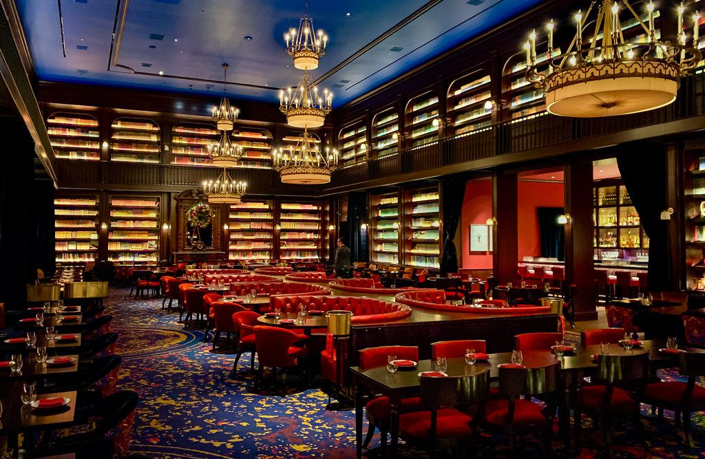 The dining room at the NoMad Las Vegas has a storybook feel — and more than 20,000 old books on the shelves. The books were purchased at auction from the personal collection of the late David Rockefeller.