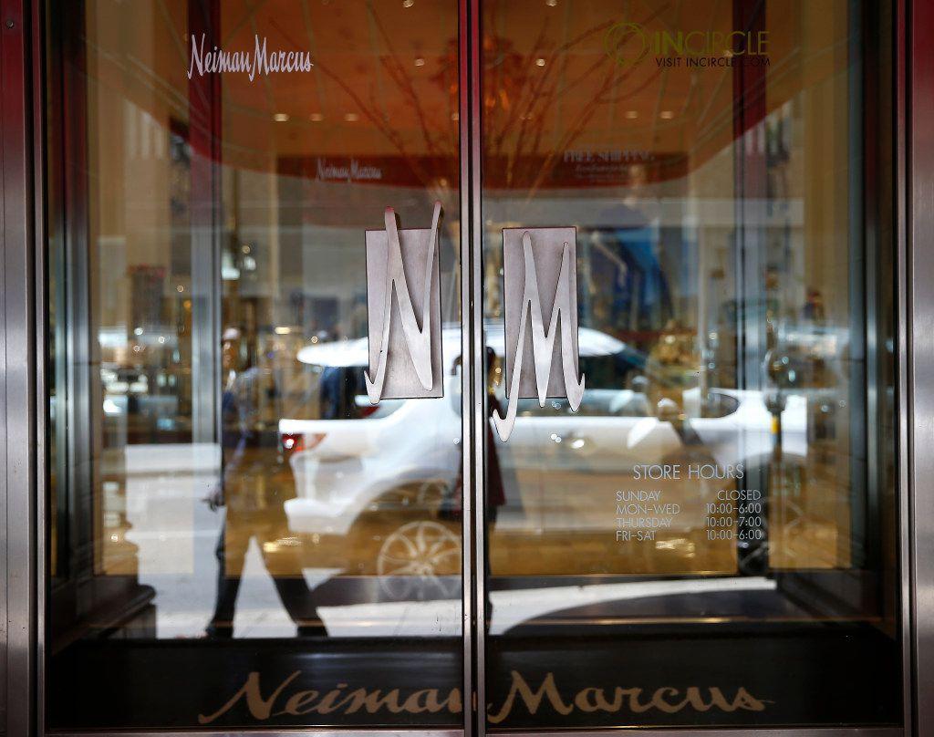 A pedestrian is reflected in the door of Neiman Marcus in downtown Dallas.