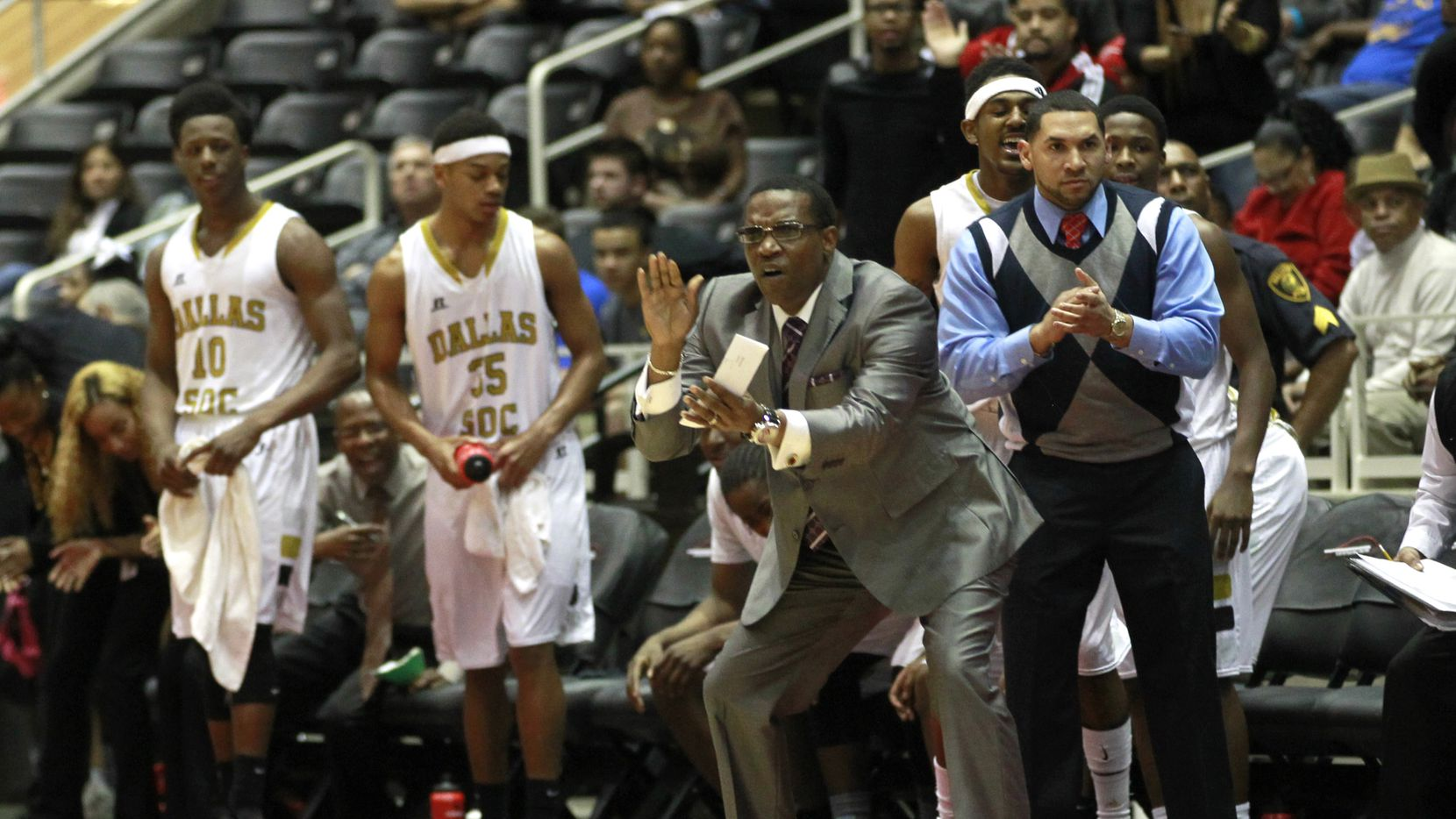 South Oak Cliff coach James Mays II directs his team during a playoff game against Lancaster.