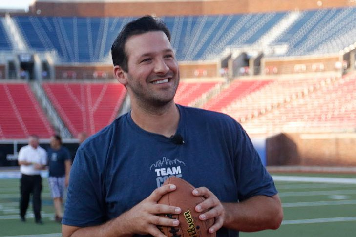 Tony Romo prepares to throw a pass to fans while they played jackpot during the Core Power Tony Romo Experience at Gerald J. Ford Stadium at SMU in Dallas on Monday, June, 8, 2015.
