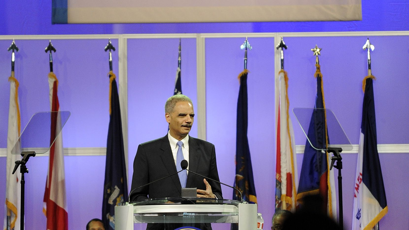 U.S. Attorney General Eric Holder speaks at the NAACP annual convention July 10, 2012, in Houston. Holder says he opposes a new photo ID requirement in Texas elections because it would be harmful to minority voters.