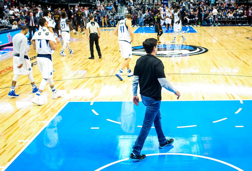 Dallas Mavericks owner Mark Cuban walks off the floor with his team after a loss to the Atlanta Hawks in an NBA basketball game at American Airlines Center on Saturday, Jan. 7, 2017, in Dallas. (Smiley N. Pool/The Dallas Morning News)