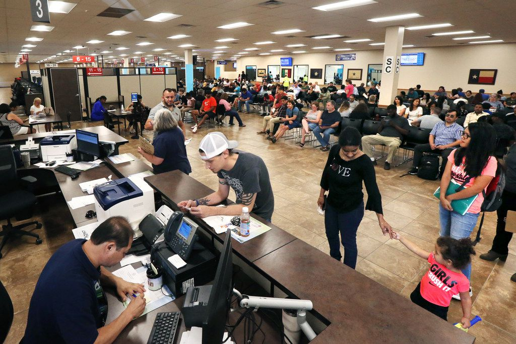 "People check in and prepare to sit and wait to get called to get a drivers license or state i.d. inside a ""mega center"" run by the Department of Public Safety in Carrollton, Texas on Tuesday, Aug. 20, 2018. (Lynda M. Gonzalez/The Dallas Morning News)"