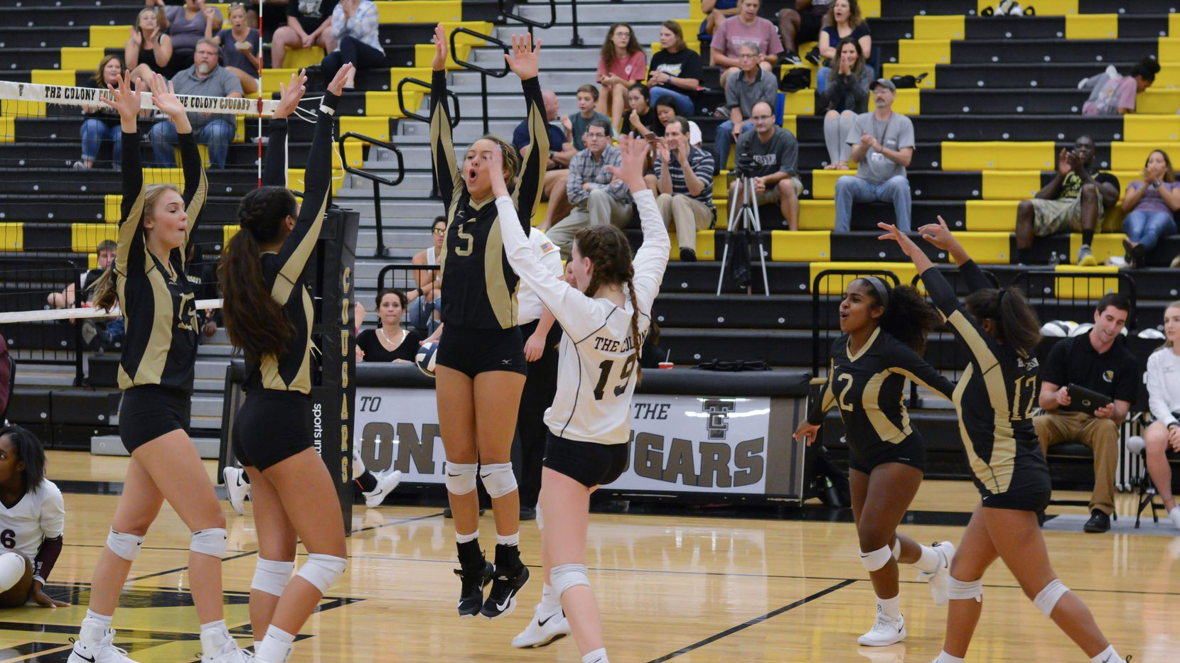 The Colony's Jayda Coleman (5) leaps to celebrate a point with teammates in a recent match. Coleman, a star shortstop on the school's softball team, says these are the volleyball moments she most enjoys.