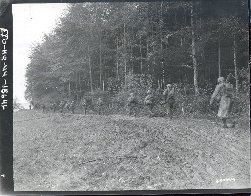 "Members of the 442nd Regimental Combat Team head out to relieve the ""Lost Battalion"" on Oct. 25, 1944, in the forests of eastern France."