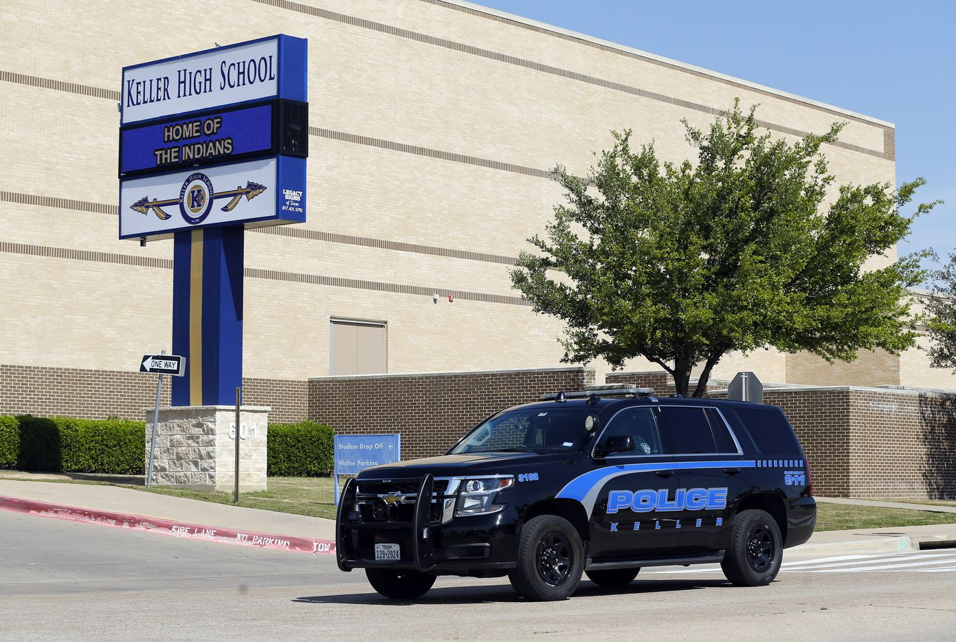 A Keller police officer patrols outside Keller High School after Keller ISD officials received information indicating an act of violence would take place at either the pep rally or student-organized walkout.
