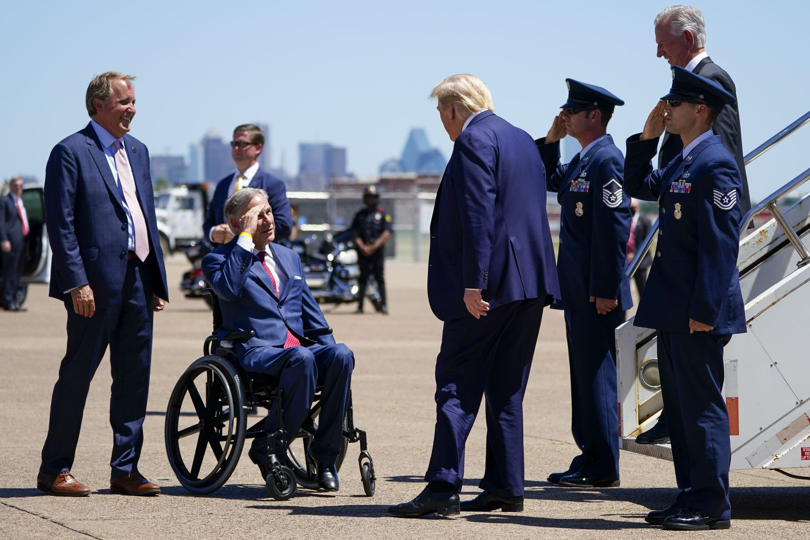 (from left) Texas Attorney General Ken Paxton and Gov. Greg Abbott greet President Donald Trump at Dallas Love Field on Thursday, June 11, 2020, in Dallas. (Smiley N. Pool/The Dallas Morning News)