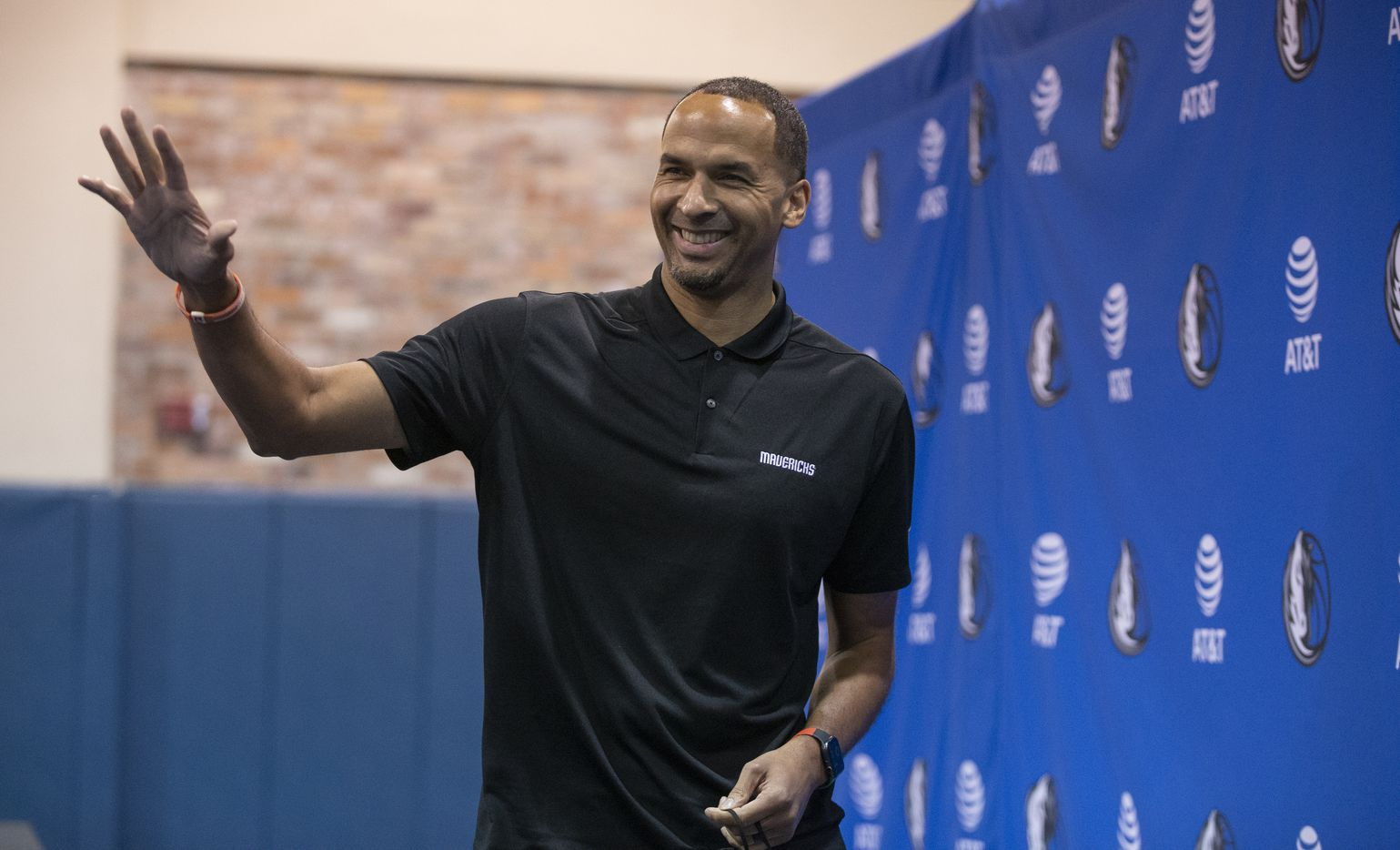 Dallas Mavericks General Manager Nico Harrison waves as he leaves a press conference in Dallas, Friday, August 27, 2021. (Brandon Wade/Special Contributor)