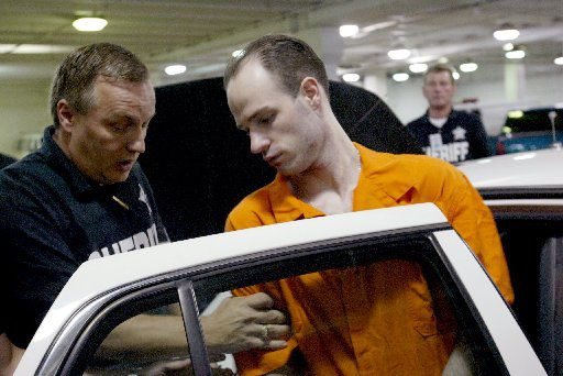 After being sentenced to death in 2003 for his role with six other escapees who killed Irving police Officer Aubrey Hawkins on Christmas Eve 2000 , Randy Halprin is escorted in the basement of the Frank Crowley Criminal Courts building in Dallas into  a Dallas County Sheriff's car.