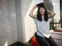 Ruby Wang, a concept artist at Flight School Studio, poses with a VR headset during a portrait session on July 9, 2020 in Dallas.