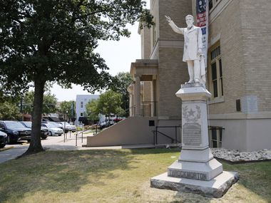 A statue of James W. Throckmorton, a Confederate brigadier general, sits in the McKinney square in downtown McKinney.