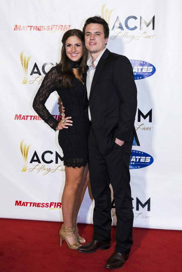 Country music artist Josh Dorr and Gretchen Skatula pose for photos on the red carpet.