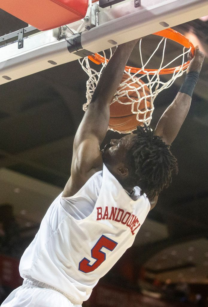 Southern Methodist Mustangs guard Emmanuel Bandoumel (5) dunks the ball during the first half of an NCAA basketball game between the SMU Mustangs and the University of Central Florida Knights at Moody Coliseum in University Park, Texas, on Wednesday, Jan. 8, 2020.