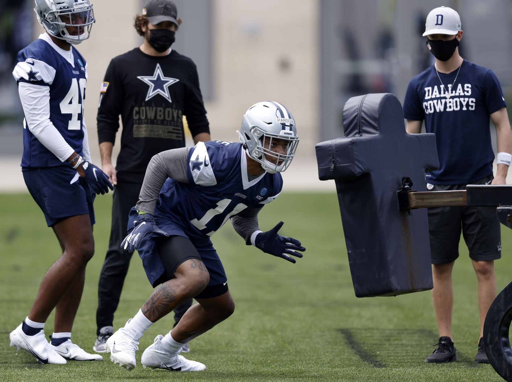 Dallas Cowboys rookie linebacker Micah Parsons (11) hits the sled for the first time since a Penn State practice for the Cotton Bowl during rookie minicamp at the The Star in Frisco, Texas, Friday, May 14, 2021. Parson sat out the 2020 season after the Big 10 couldn't decide wether to start the season. (Tom Fox/The Dallas Morning News)