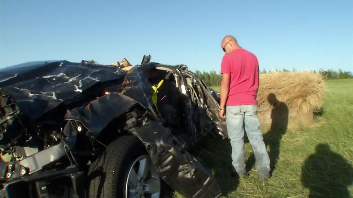 Brandon Edwards returned Sunday to a battered vehicle that had been pulled off State Highway 64 by a tornado. (KXAS-TV (NBC5))