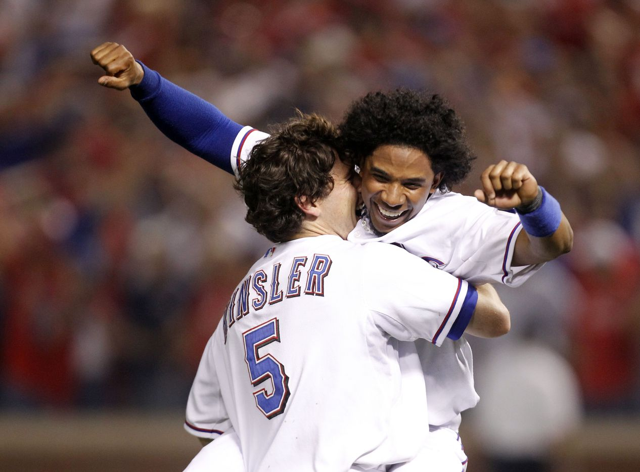 Texas Rangers Ian Kinsler (5) and Elvis Andrus (1) celebrate a victory over the New York Yankees during American League Championship Series in game six at Rangers Ballpark in Arlington on October 22, 2010, in Arlington, Texas. The Rangers won 6-1 to win the AL championship. (Vernon Bryant/The Dallas Morning News) 10242010xSPORTS