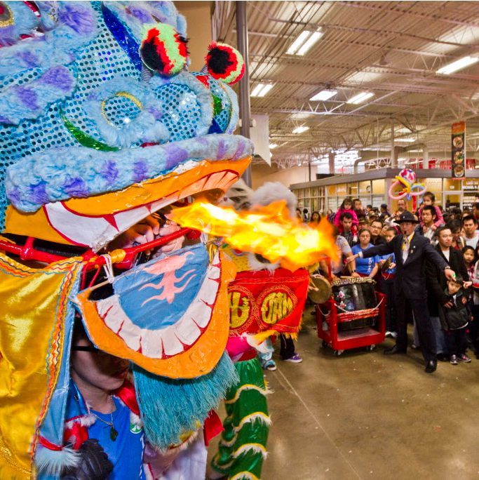 Shoppers at Asia Times Square watch a lion dance performed by members of a Vietnamese youth dance troupe.