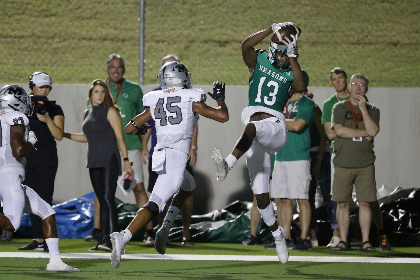 Southlake Carroll receiver RJ Maryland (13) catches a touchdown pass in front of Arlington Martin defender Cadynce Hall during a high school football game in Southlake, Texas on Friday, Sept. 17, 2021. (Michael Ainsworth/Special Contributor)