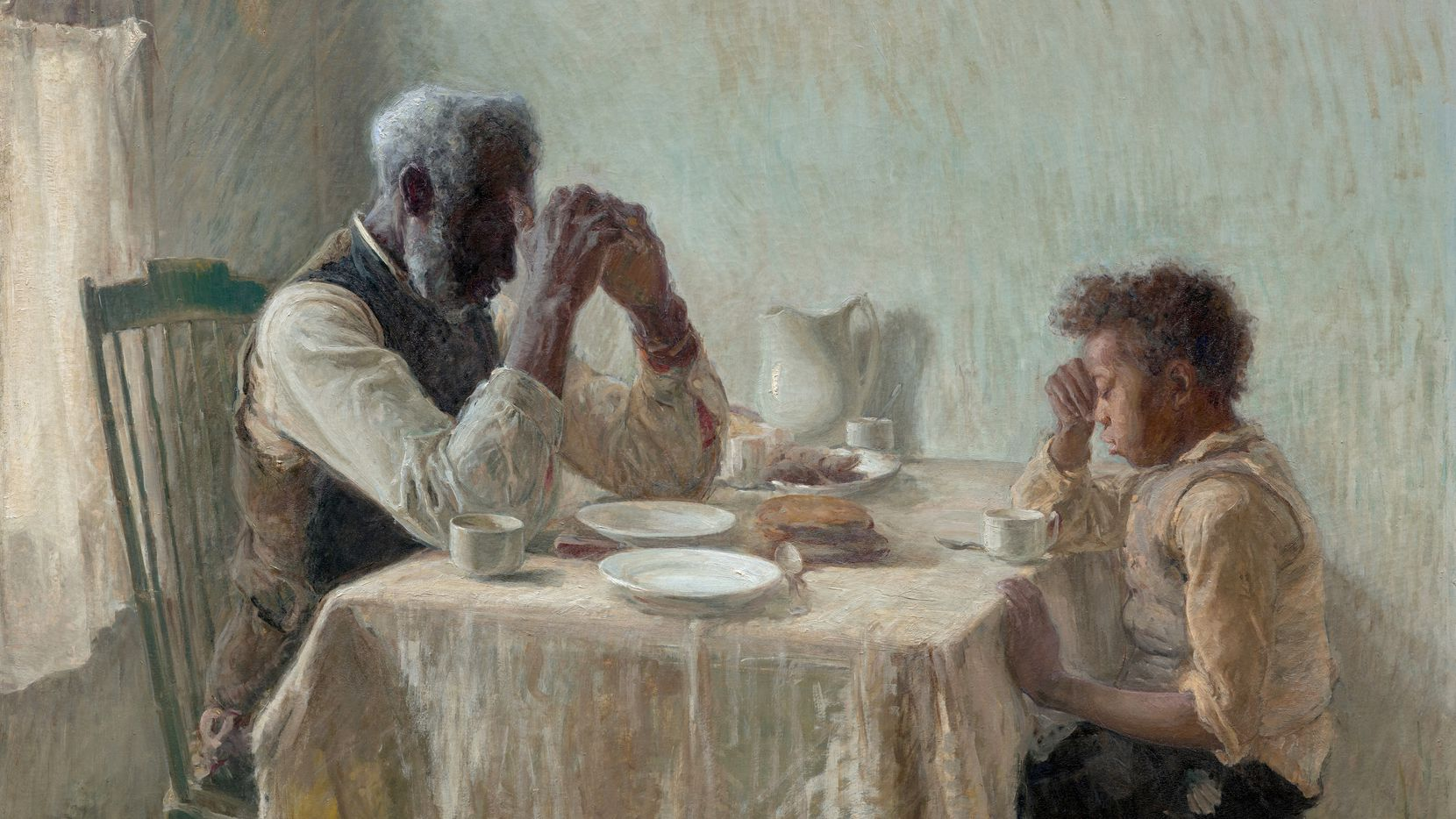 """Henry Ossawa Tanner's """"The Thankful Poor,"""" from 1894, shows a young boy and his grandfather with their heads bowed in prayer over a humble meal. Tanner's two-painting exhibition continues through Jan. 2 at the Dallas Museum of Art. (Dallas Museum of Art)"""