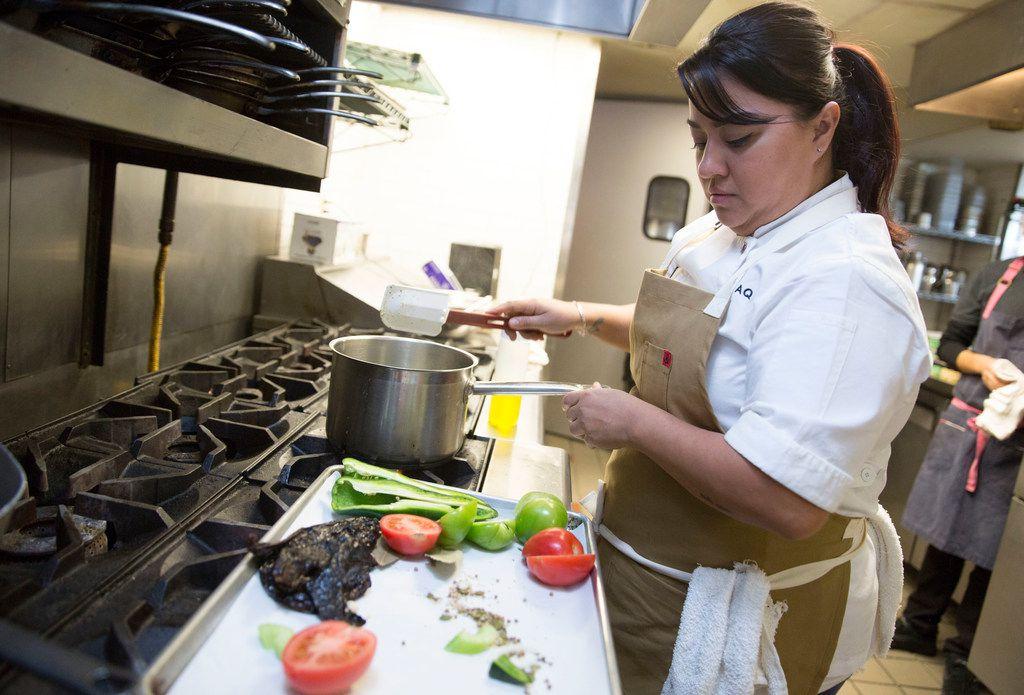 Cedars Social chef Anastacia Quinones (CQ) prepares mole in the kitchen at the restaurant in Dallas, Texas, Saturday, February 3, 2018. (Allison Slomowitz/ Special Contributor)