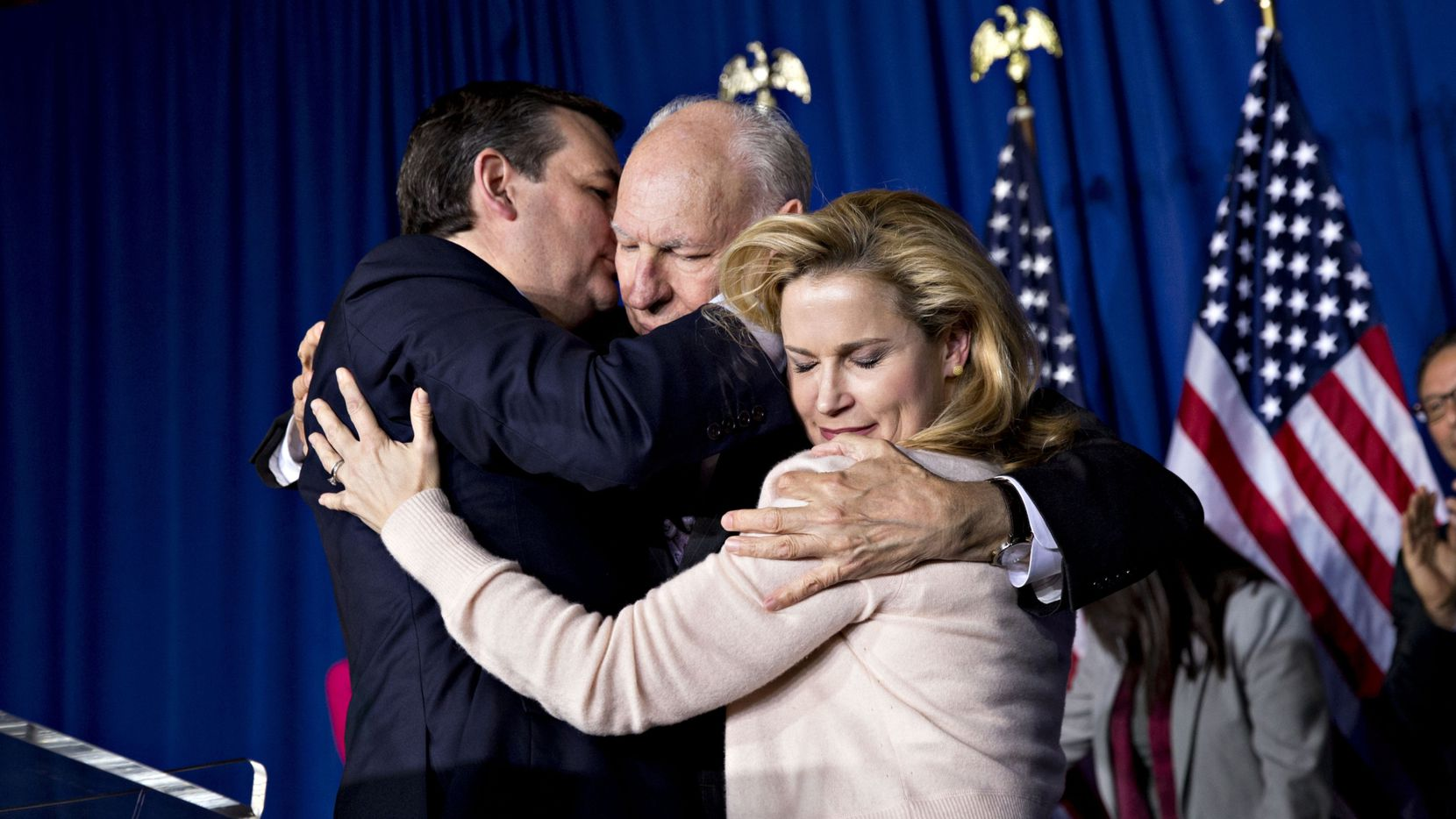 Sen. Ted Cruz embraces his father, Rafael Cruz, and wife Heidi after suspending his presidential campaign in Indianapolis on May 3. (Bloomberg/Daniel Acker)