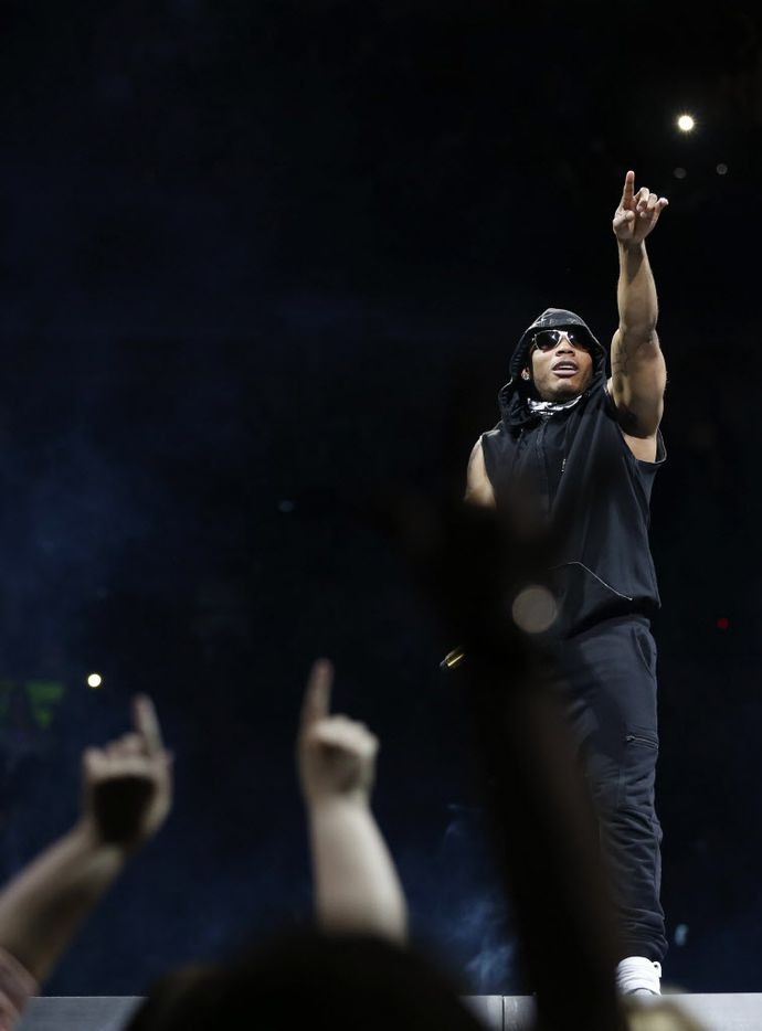 Musical recording artist Nelly acknowledges the crowd during a performance at American Airlines Center in Dallas, on Thursday, May 14, 2015.