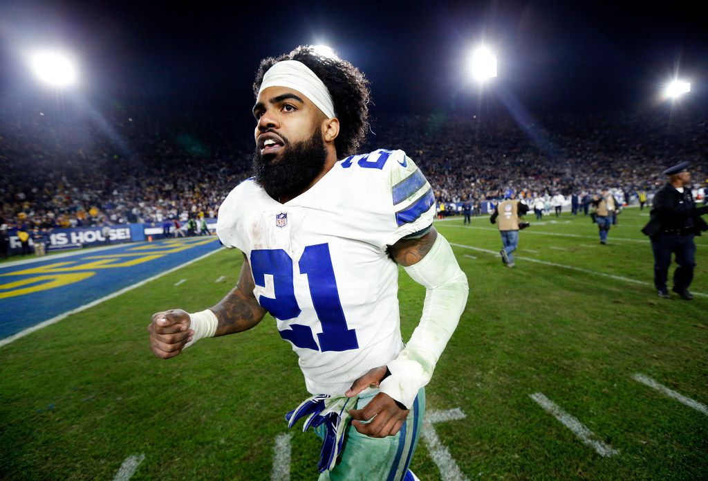 Dallas Cowboys running back Ezekiel Elliott (21) races to the locker room after the final seconds ticked of the clock of their NFC Divisional Playoff game against the Los Angeles Rams at Los Angeles Memorial Coliseum in Los Angeles, Saturday, January 12, 2019. The Cowboys lost 30-22. (Tom Fox/The Dallas Morning News)