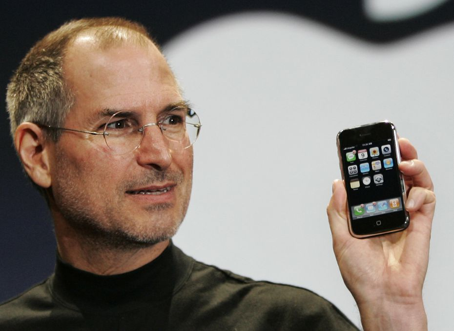 Apple CEO Steve Jobs showed off the company's first iPhone during a keynote address at MacWorld Conference & Expo in San Francisco in 2007.