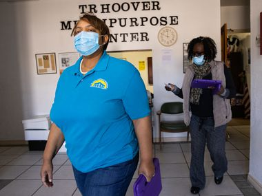 Executive director Sherri Mixon (left) heads out to the vaccine registration at T.R. Hoover community center in Dallas on Tuesday, Jan. 26, 2021. Mixon hopes leaning into the relationships she's established in South Dallas that she'll be able to help get people registered for the vaccine. (Juan Figueroa/ The Dallas Morning News)