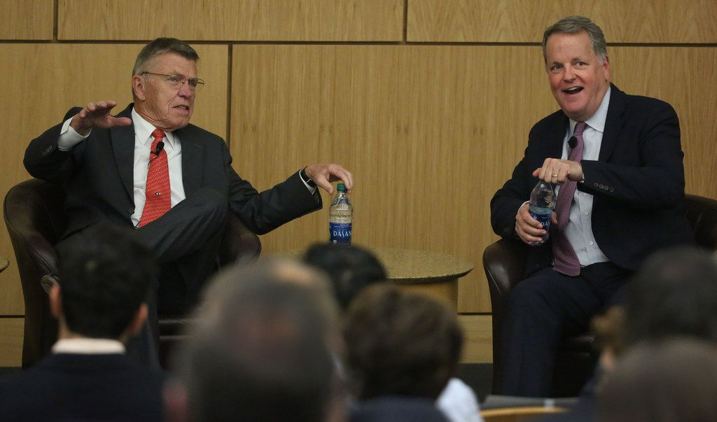 Bob Crandall (;eft), former CEO of American Airlines, and Doug Parker, CEO of American Airlines converse at the SMU Cox School of Business Crum Auditorium.