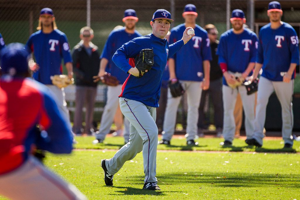 Texas Rangers pitcher Jeffrey Springs participates in a fielding drill during the first full-squad spring training workout at the team's training facility on Tuesday, Feb. 20, 2018, in Surprise, Ariz. (Smiley N. Pool/The Dallas Morning News)