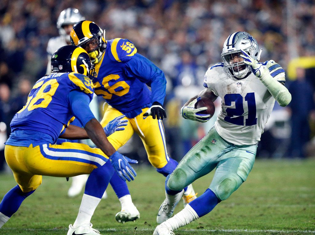 Dallas Cowboys running back Ezekiel Elliott (21) cuts back against Los Angeles Rams inside linebacker Cory Littleton (58) during the fourth quarter of their NFC Divisional Playoff game at Los Angeles Memorial Coliseum in Los Angeles, Saturday, January 12, 2019. The Cowboys lost 30-22. (Tom Fox/The Dallas Morning News)