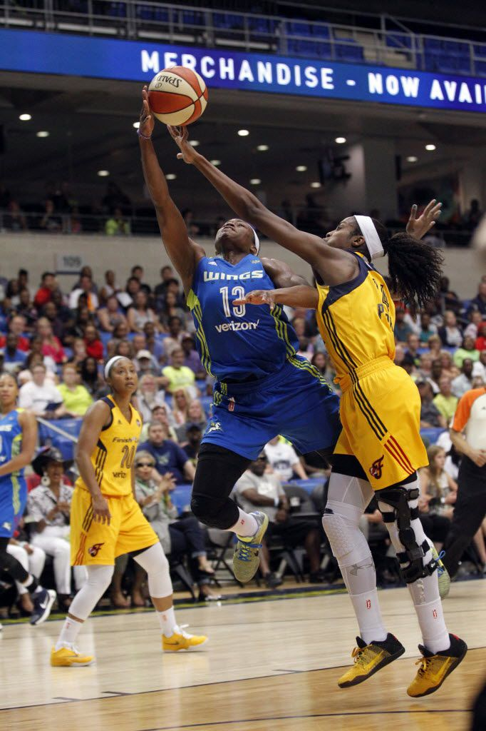 Dallas Wings guard Karima Christmas (13) makes a basket and is fouled by Indiana Fever forward Devereaux Peters (14) during the first half of their WNBA basketball game at College Park Center in Arlington, Texas on Saturday, June 25, 2016.