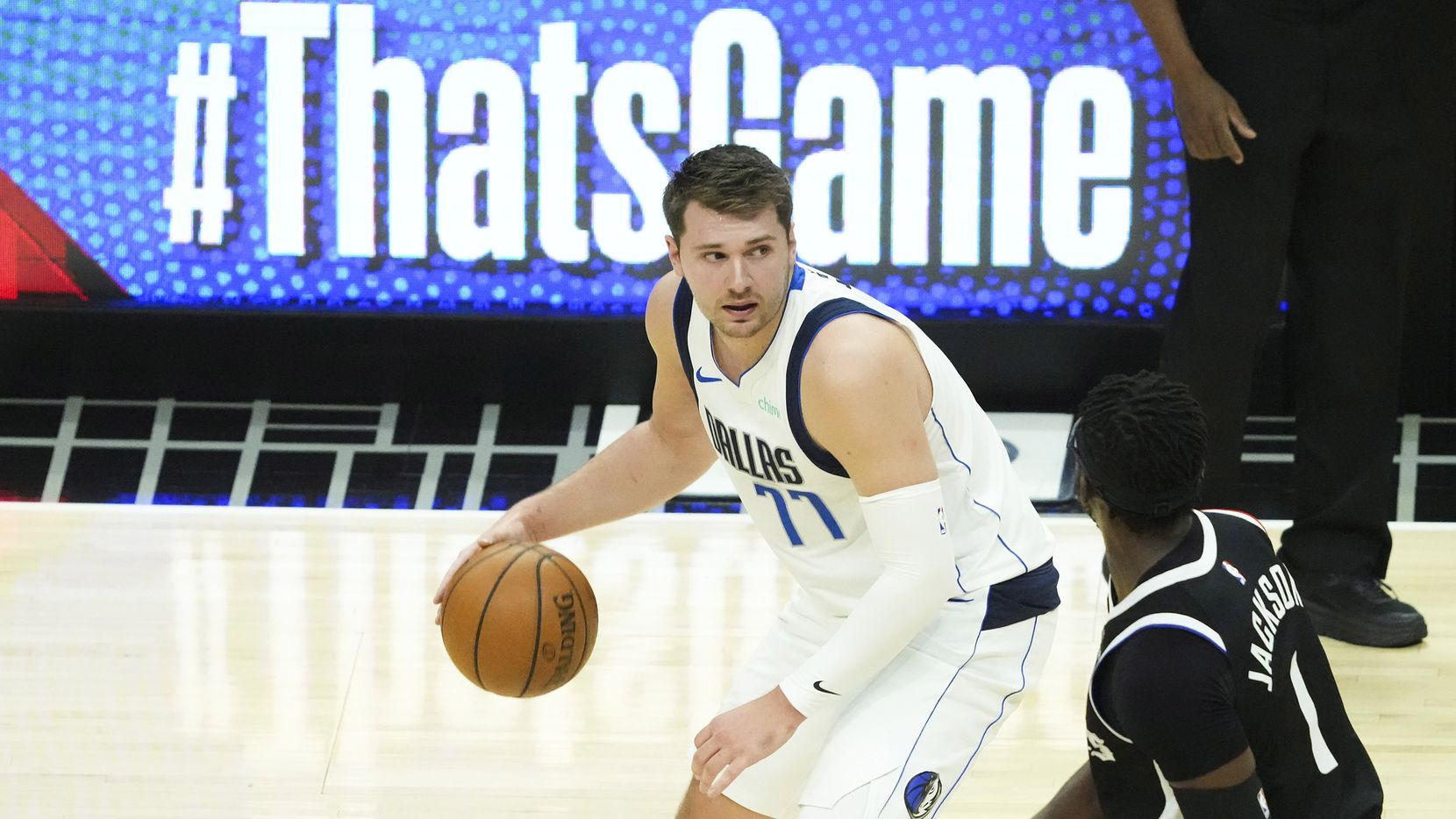 Dallas Mavericks guard Luka Doncic (77) works against LA Clippers guard Reggie Jackson (1) during the first quarter of Game 7 of an NBA playoff series at the Staples Center on Sunday, June 6, 2021, in Los Angeles.