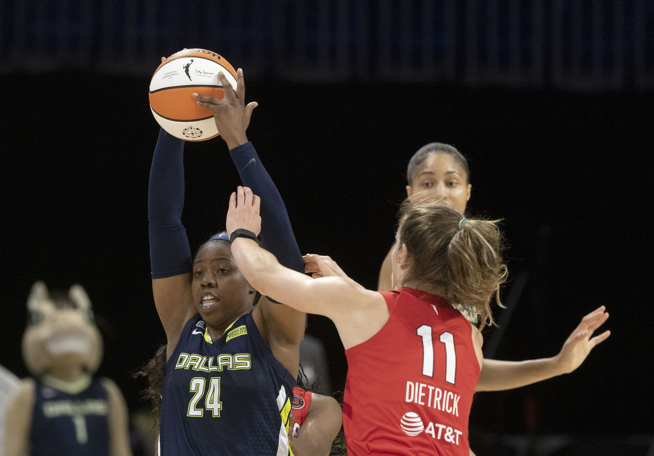 Dallas Wings guard Arike Ogunbowale (24) keeps the ball away from Atlanta Dream guard Blake Dietrick (11) during the second half of their WNBA basketball game in Arlington, Texas on Sept. 2, 2021. Dallas won 72-68. (Michael Ainsworth/Special Contributor)