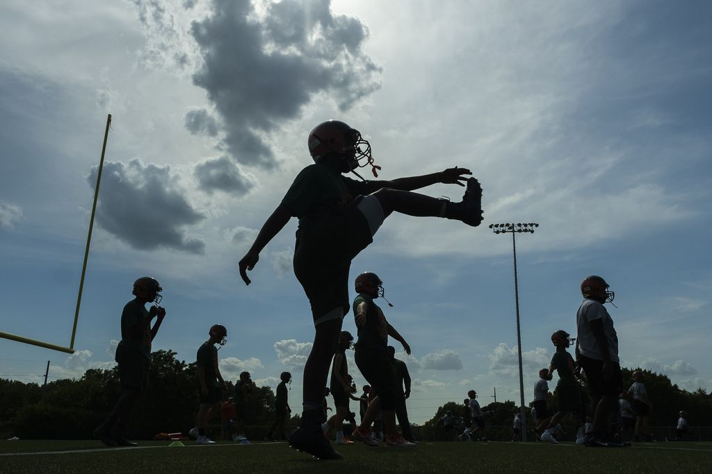 Garland Naaman Forest freshman football players practice at the school on Friday, Aug. 9, 2019, in Garland, Texas.  The teamÕs coaches delayed practice Friday by an hour an a half due to the heat index earlier in the afternoon. (Smiley N. Pool/The Dallas Morning News)