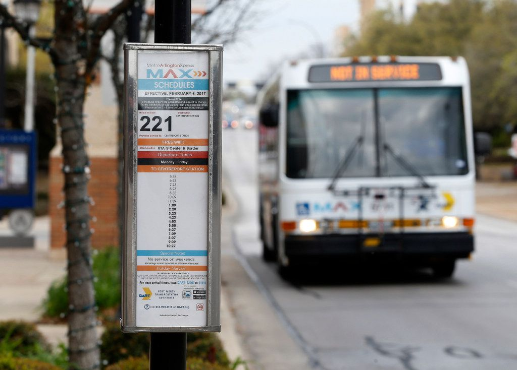 An Arlington MAX bus stops at College Park on the campus of the University of Texas at Arlington.