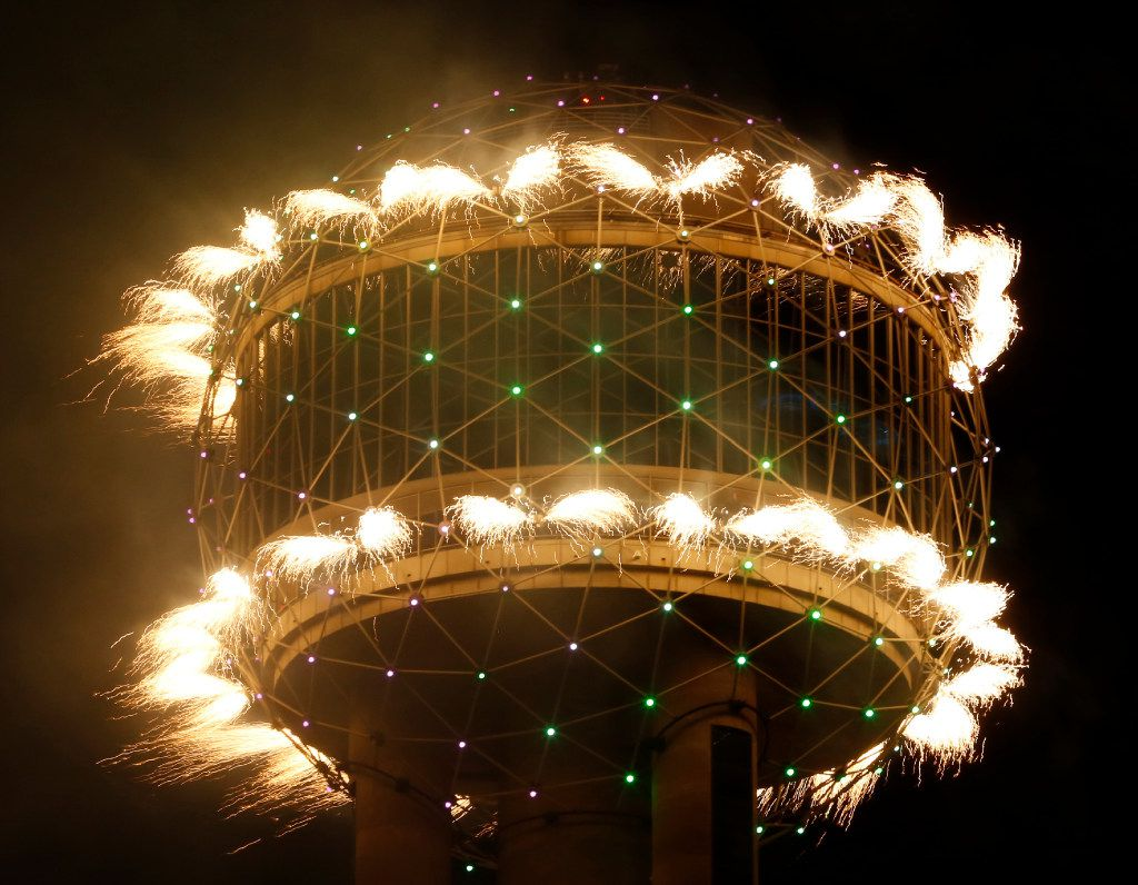 Fireworks fly from Reunion Tower during the New Year's Eve event in Dallas on December 31, 2016.