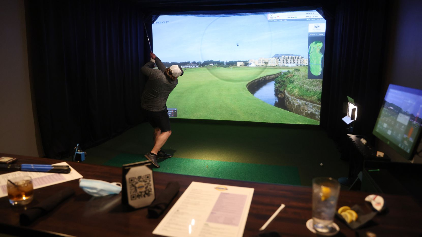 PJ Spielman plays virtual golf in one of five simulators at Daylight Golf on Thursday, January 21, 2021in Grapevine, Texas.