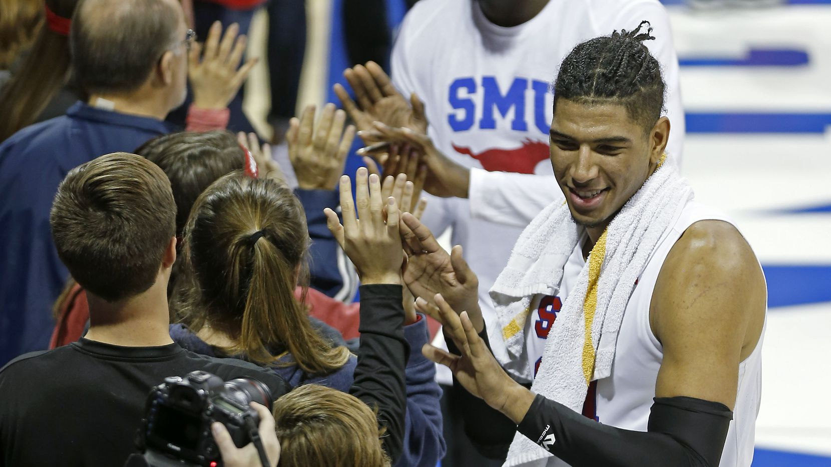 SMU forward Everett Ray (24) celebrates a 72-37 win over Arkansas-Pine Bluff with fans at Moody Coliseum in Dallas, Saturday, Nov. 18, 2017.