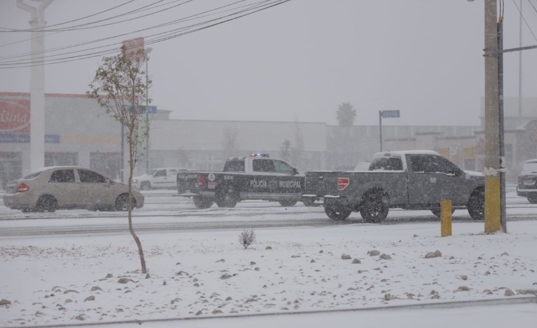 Snow falls in Ciudad Juarez, Mexico, on Sunday.