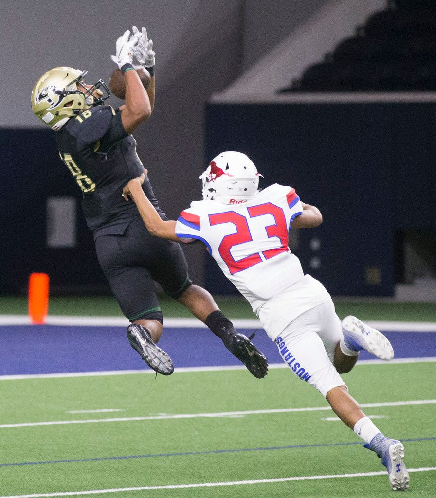 FILE - Birdville wide receiver Carter Self (18) as misses a pass as Grapevine defensive back Devante Williams trails behind him during a high school football game at Ford Center at The Star in Frisco, Texas on Saturday, December 1, 2018. The Birdville Hawks beat the Grapevine Mustangs 28 to 21 in overtime. (Daniel Carde/The Dallas Morning News)