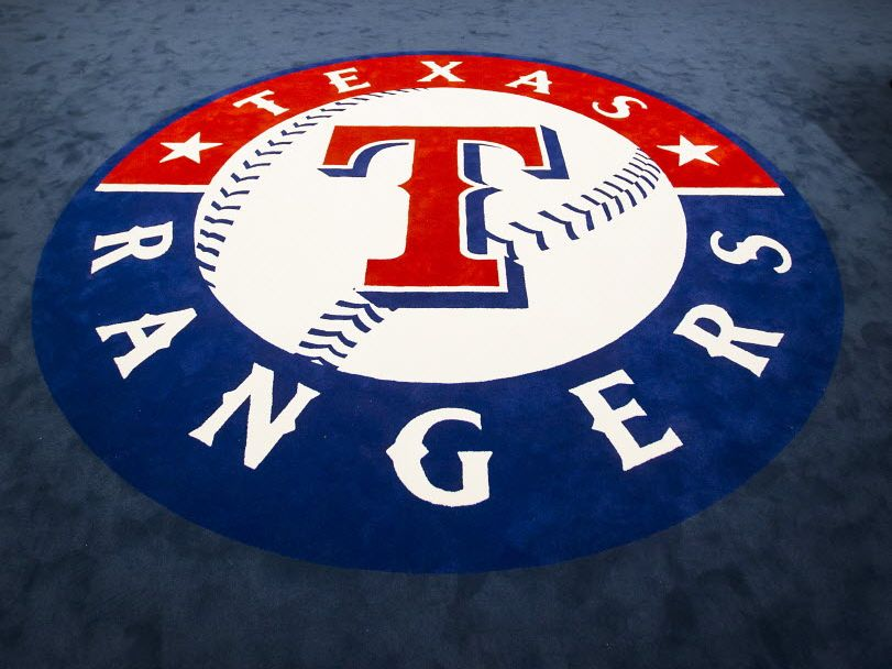The team logo fills the center of the room in the clubhouse of the Texas Rangers newly renovated spring training facility as seen during a media tour on Thursday, Feb. 18, 2016, in Surprise, Ariz. (Smiley N. Pool/The Dallas Morning News)